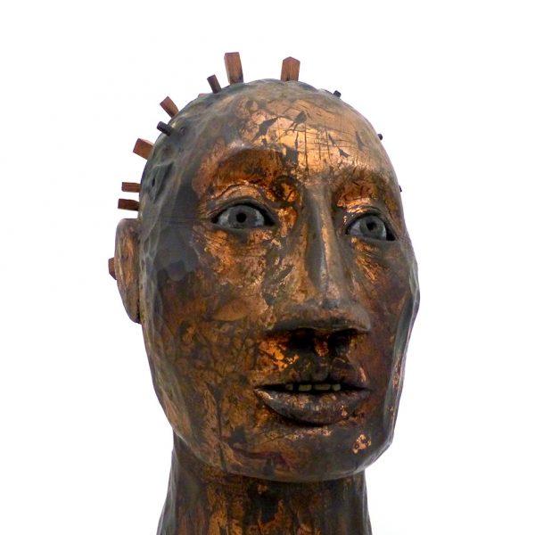 Ancient Immigrant, Carlos Zapata 2020. Polychrome wood. H 35 x W 16 x D 18 cm.
