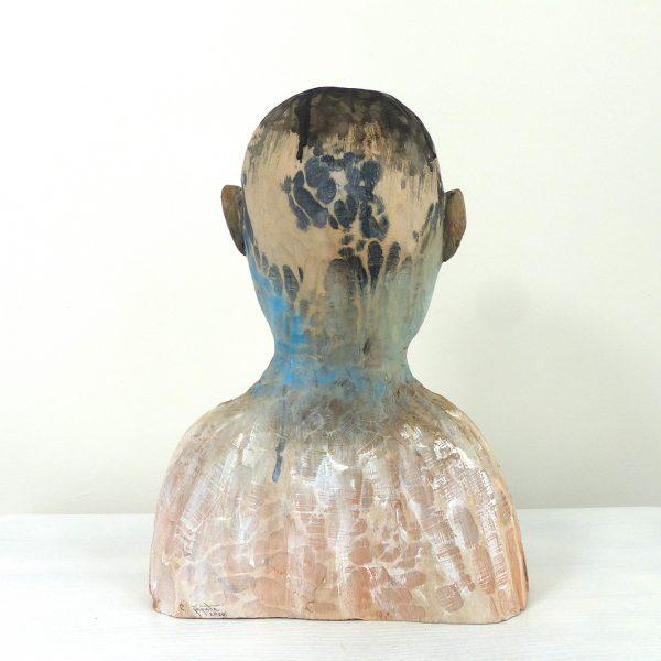 Boy, Carlos Zapata 2020. Polychrome wood, 45 cm high.