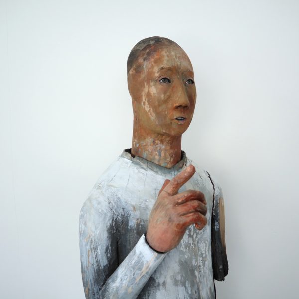 Trail of Tears, Carlos Zapata 2021. Polychrome carved wood and glass eyes, 90 H x 40 W x 42 D cm.